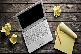 rsz_bigstock-laptop-with-blank-notepad-and-35817068